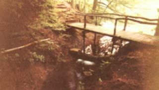spillway and wooden foot bridge