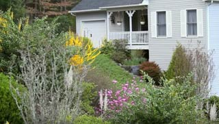 house with flowers on side